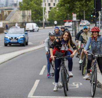 People riding bikes in a cycle lane - Zero Emissions Network