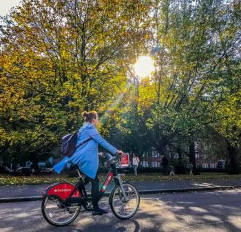 Woman cycling on a Santander Cycle - Zero Emissions Network