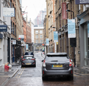 London street with electric car