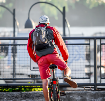 Man With Backpack Learning to Cycle - Zero Emissions Network