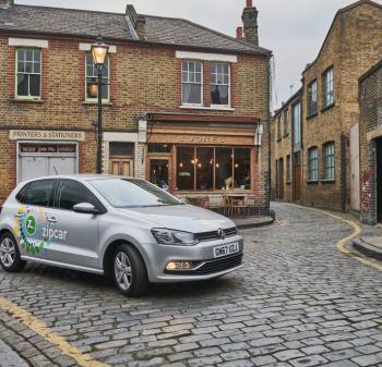 Zip car on cobbled street